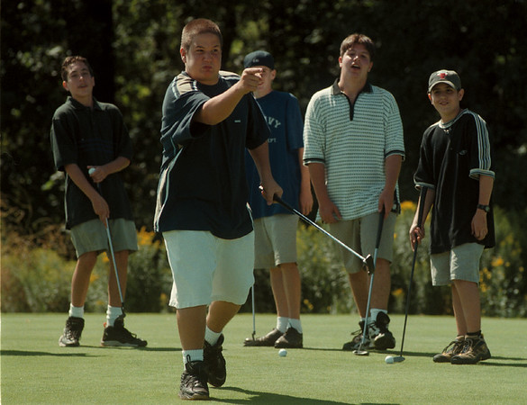 98/08/12-- junior golf--Takaaki Iwabu photo-- Gabe Casale, 14, Ransomville, reacts to his missed-shot as he and other local young golfers brush their putting skills during the MayorÕs 21st Annual Hyde Park Jr. Tournament. <br /> <br /> sports, bw, Thursday