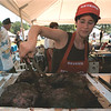 98/08/02--TASTE OF LEWISTON--DAN CAPPELLAZZO PHOTO--SHANNON STARMER, OF SIR LOIN'S OSTRICH RANCH, RANSOMVILE. TURNS THE OSTRICH STAKES AT THE TASTE OF LEWISTON IN ACADEMY PK.<br /> <br /> 1A