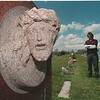 "5/15/97 Niagara Monument 2 - James Neiss Photo - James E. Farchione, co owner of Niagara Monument Works Inc.,  shows his Sculptur of ""Christ with Thorn Crown"" on a stone for a Niagara  Falls Family carved out of  India Red Stone."