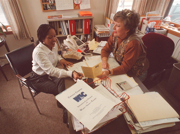 2/21/97 WIC Program - James Neiss Photo - Pamela Rankin of NF goes over her case file with Claudia G. Weber Director of the Catholic charities WIC Program on 4th St. NF.