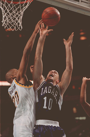 97/12/12--NU basket 2--Takaaki Iwabu photo-- Niagara University Mike Piwerka, right, jumps for a rebound against Dale Sawyers of Canisius.