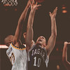 97/12/12--NU basket 2--Takaaki Iwabu photo-- Niagara University Mike Piwerka, right, jumps for a rebound against Dale Sawyers of Canisius.