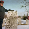 98/1/28 Warren corner-Rachel Naber Photo-Floyd Yousey stands on the gravesite of the settlers of Warrens Corners.