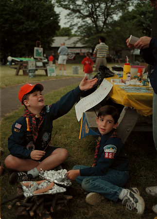 98/06/12 - Trail Day--Takaaki Iwabu photo-- Members of Cub Scout 855 of Lewiston participated in National Trail Day Saturday at Whirlpool State Park Saturday. Cooking their own lunch is Peter Violante, left, and Jacob Barnett, both 9. <br /> <br /> lcoal. bw. w promo