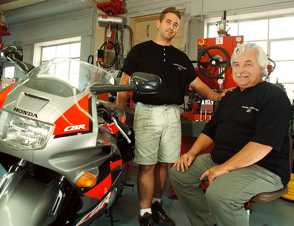 7/22/97-- powerspoorts --Takaaki Iwabu Photo --From left, Will O'Connor and Bill O'Connor at Niagara Powersports, the new business in Ransomville. <br /> <br /> tmc photo
