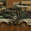 98/12/10 Bell Aerospace Lot - James Neiss Photo - Lot boys work with new cars in this Leaseway Overflow lot on Niagara Falls Boulevard in the old Bell Aerospace parking lot.