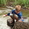 98/07/23 Looking *Dennis Stierer Photo -<br /> Looking for crayfish is fun says Adam Taylor, 8 from Kendall. He loves to come down to visit his grandmother in Medina and go over to Butts park along the creek and look for crayfish.