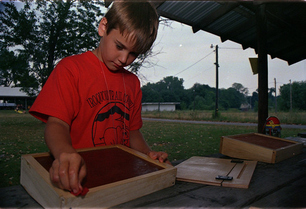 98/08/06 Scout Wood Work-Rachel Naber Photo-Cole Nesbitt of Den#4 works on a lap top desk at Boys scout day Camp in Albion.