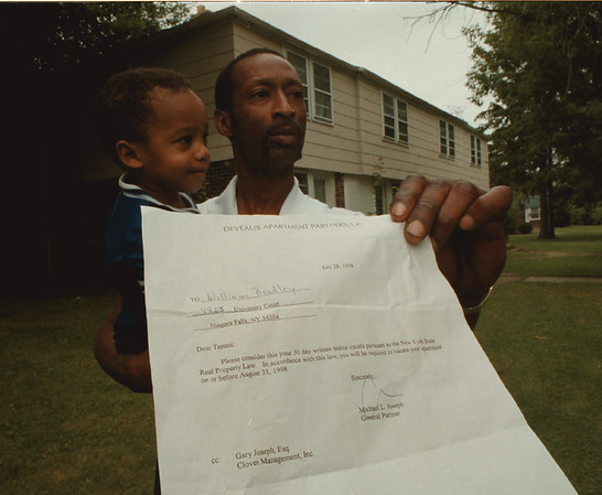 98/07/30 30 Day Eviction - James Neiss Photo - William Bradley and son Isaiah Bradley 21mos., of 4808 University Court is upset with the 30 day notice to move out of his  apartment. He and all the other University Court residence must be out by August 31, 1998. He is a single father and forsee's a hardship.