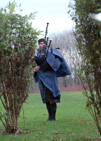 98/11/11 Stands Alone *Dennis Stierer Photo -<br /> Mo Britt, with the Sherriffs Dept. stands alone as he plays his bagpipes during the Veterans Day activities at Outwater Park.