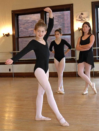 "98/11/04 Ballerina  *Dennis Stierer Photo - COLOR<br /> Six year old Mary Stoddard practices as her sister, Caroline Stoddard and her friend, Jessica Whitley look on.  Mary was accepted to play a part in the ""Nutcracker"" with the Pittsburg Ballet."