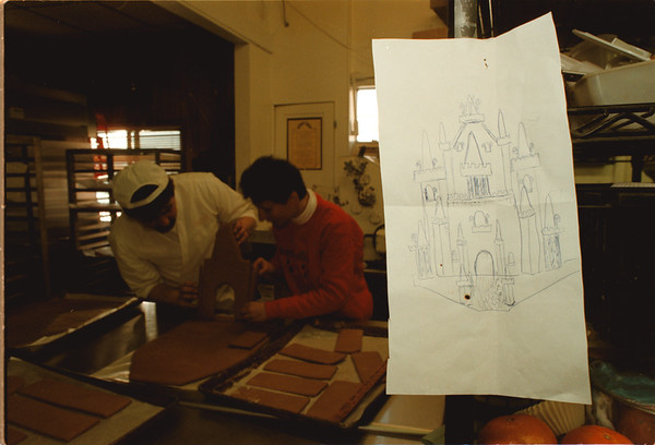 98/12/02 Gingerbread - James Neiss Photo - A drawing shows what the gingerbread house should look like as Ernest Ramstetter, co owner of Muscoreils Fine Desserts and Gail Sprenger, owner of Galassi Sub Shop both decide how it will be put together.