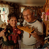 98/07/29-- Mulcahy -Takaaki Iwabu photo-- John and Peggy Mulcahy, toy collector/seller from Sanborn, hold Ty Bears and Victorian Figures at their house. (Feature, BW with promo...