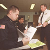 3/20/97 Police HAZMAT Teem - James Neiss Photo - L-R - Rich King and Russell DeFranco, NFPD Officers, work with Capt. Andrew Viglucci in setting up a HAZMAT unit at the NFPD.