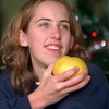 98/12/08 FFA Fruit-Rachel naber Photo- Karen Eick displays the one of the fruits that  the Future Farmers of America Club at Medina High School is selling to this week between 8 and 7 pm, Sat 9-5pm. The proceeds of the sale benefit the FFA trip to the state convention, summer leadership program, and money to plant crops in a land lab in the spring.
