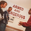 9/17/97--LOMAX BARNES--DAN CAPPELLAZZO PHOTO--DIR OF YOUTH MOTOVATION MOVEMENT LOMAX BARNES SPEAKS TO 15-YR-OLD TERE MOORE AND 17-YR-OLD MARK MARTIN AT THE  NEW JERUSALEM REVIVAL CENTER.<br /> <br /> SAT FEATURE