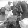 1/2/97 garbege, bw--Takaaki Iwabu photo-- Allen Seefeldt, left, and Charles Mixon, employees of Modern Disposal Servieces, collects the trash bags on 72nd Street Thursday. <br /> <br /> 1A, Friday