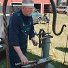 5/26/97--WILSON FEST. 2--DAN CAPPELALZZO PHOTO--BLACKSMITH DICK GEIER, OF WILLOW FORGE, LOCKPORT CHECKS A LENTH OF IRON ROD IN HIS BOOTH AT THE WISLON MEMORIAL DAY FESTIVAL.<br /> <br /> LOCAL/GRAPEVINE