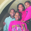 1/23/97--family picture 1--Takaaki Iwabu photo-- Mother Krystal Chandler with her children, from left, Kendric Chandler, 11, Shayla Chandler, 9, and Kristin Frazer, 3. (for Judy's story on Black family)<br /> <br /> Sunday, feature