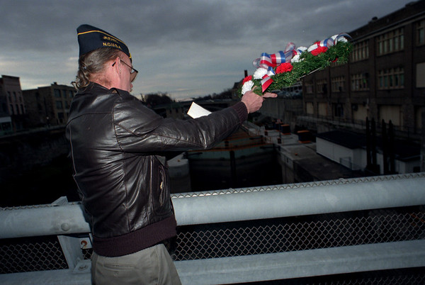 98/12/07 pearl harbor--dan cappellazzo photo--retired us navy man karry freeberg throws a wreath into the canal at the cottage st bridge in memory of those fighting men who gave their lives for our country during apearl harbor day ceremony infront of city hall.