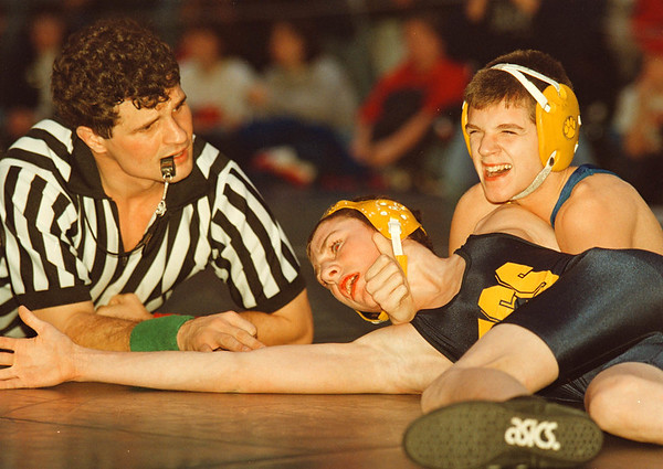 2/1/97-- Invitational 1--takaaki iwabu photo-- Lockport HS Frank Conjerti, right, tries to pin down Franklinville HS's Damon Logue on the floor during the 100-pound semi-final match at Lancer's Invitational Saturday. <br /> <br /> sports, Sunday