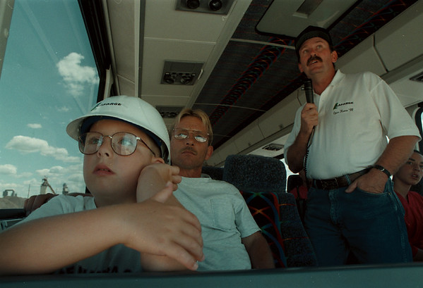 98/08/01--Open House --Takaaki Iwabu photo-- Matt Bugay, 7, observes a quarry operations with his father Gil Bugay during the bus-tour at Lafarge Niagara's open house Saturday. Explaning the operation at right is Dave Gross.  /Sunday, local, bw with promo