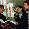 4/10/97-- health food--Takaaki Iwabu photo-- Carol Ross, left, owner of Lewiston Natural Health Food Store, talks to Stefania and Lusia Spadafora, who attend Ross's class on health food. <br /> <br /> tmc photo