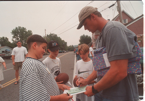 "97/09/02 Big Brother - James Neiss Photo - Buffalo Bills players fished with supporters of the ""Riedman Insurance Fishing Classic"" to Benefit the Big Brothers Big Sisters of Niagara county. Here L-R, Little Brothers Adam 12yrs, Nick 13yrs and Shawn 11yrs get autographs signed by Buffalo Bills player Todd Collins."