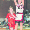 1/3/96-- nw basket-- NW Angela Tylec makes a jump shot Friday's game against Wilson HS. (She made a record)<br /> <br /> sports, Saturday