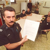 2/21/97 Sick Day Policy - James Neiss Photo - Capt. Stefan Kundal, Union President of Local 3359 Fire Officers Association, shows the memo fire fighters recieved about the sick day policy change.
