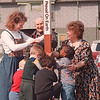 "4/16/97--HANCI/PEACE POLE--DAN CAPPELLAZZO PHOTO--(LTOR)MARY ELLEN MURRAY, MONTASARY CONSULTANT, GORDON PAUL, ADULT DAY CARE MEMBER (CENTER REAR) AND DIR. OF HANCI CHILD LEARNING CENTER WENDY HARRIS GET HELP FROM CHILDREN OF THE VA LEARNING CENTER TO ERRECT THE PEACE POLE  IN THE INTERGENERATIONAL GARDEN. THIS HELPS MARK THE WEEK OF "" CELEBRATION OF THE YOUNG CHILD."""