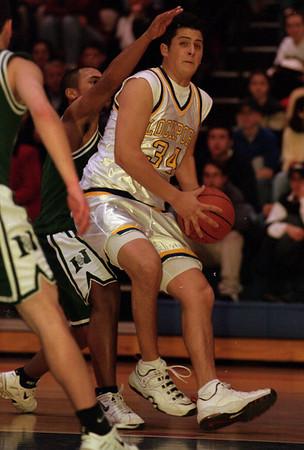 98/02/13--boys basket 2--Takaaki Iwabu photo-- Lockport HS Casey Mullett (#34) goes under the basket against Nichols Nichols HS defenders during the Saturday's Niagara Frontier Championship game.<br /> <br /> lockport, bw, photobin