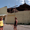 98/09/07 Wind Damage *Dennis Stierer Photo -<br /> Sue and Jeff Burris, owners of Burt Bait and Tackle, rent some space in this building owned by Jim McDonough that was damaged Sunday night by high winds.