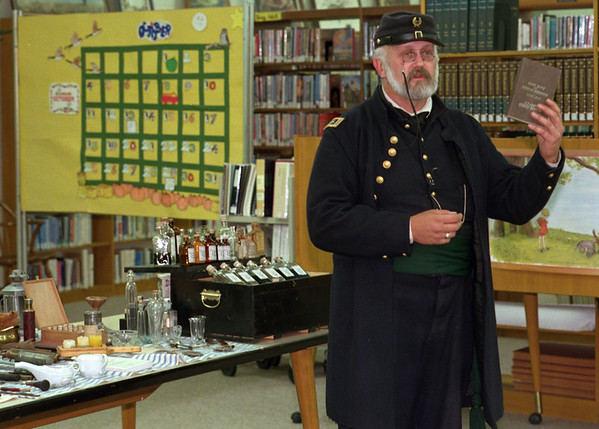 98/10/07 Civil War Surgeon *Dennis Stierer Photo - Color<br /> Civil War re-enactor Joel Emerson portrays Lt. Lucius Emerson, MD, as assistant surgeon with the 155th New York Volunteer Infantry during a talk at the Lee-Whedon Memorial Library on Wednesday evening.