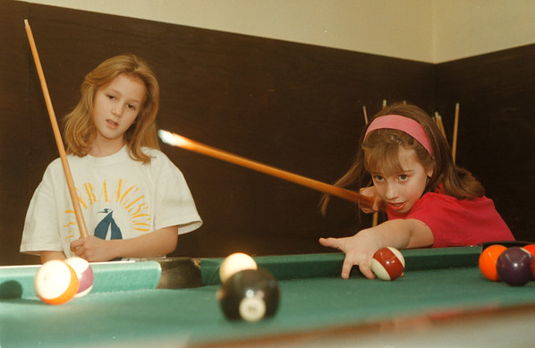 98/02/11-- PAL --Takaaki Iwabu photo-- Amanda Reilly, 8, left, and Kayla Husarek, 9, play a pool at the Niagara Police Athletic League's gym at 9501 Colvin Ave. (for Bill's story on area's after school program for kids) <br /> <br /> Sunday, color, 1A