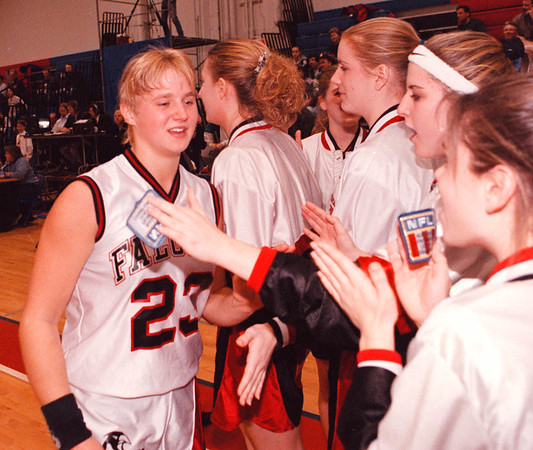 2/12/97--GIRLS NFL HOOPS FINAL--DAN CAPPELLAZZO PHOTO--N.W. ANGELA TYLEC IS CONGRATULATED BY HER TEAMMATES AFTER THEIR 45 TO 44 VICTORY OVER NICHOLS IN THE NFL FINAL.<br /> <br /> SP