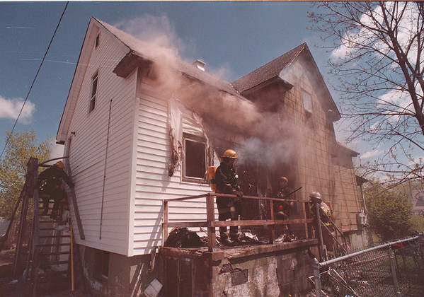 5/20/97 House Fire 2 - James Neiss Photo - Niagara Falls Fire Fighters battle a smoker at 758 16th street.