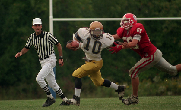 98/09/12 Niagara HS FB-Rachel Naber Photo-Eric Mc Allister carries the ball for Sweet hoem as James Caraglin tries to take him down.