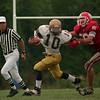98/09/12 Niagara HS FB-Rachel Naber Photo-Eric Mc Allister carries the ball for Sweet hoem as James Caraglin tries to take him down.