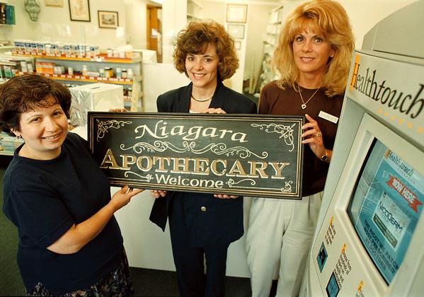 7/22/97--Apothecary--Takaaki Iwabu photo-- New business on Niagara Falls Blvd, Niagara Apothecary. From left, Andrea Wrobel, pharmacy technician, Jamie Whalen-Schilff, pharmacist, and Shirley Chirello, pharmacy technician. <br /> <br /> money, Wednesday