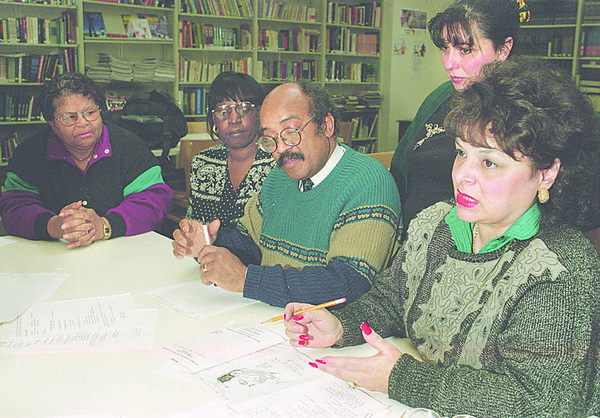 1/14/96-- MR King 2--Takaaki Iwabu photo-- Officials of Niagara Community Center prepare for the Martin Ruther King Day's luncheon. From left, Pauline Walker, Glenda Glover, Herman Boyer Jr., Catherine DeSantis and Cynthia Bianco. <br /> <br /> 1a monday