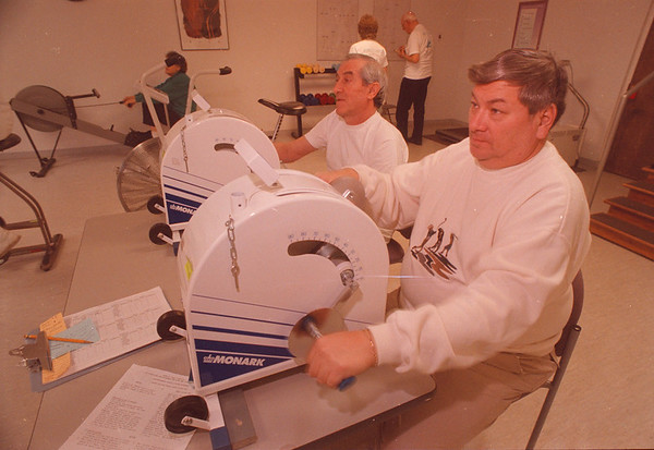 "3/17/96 Cadiac Rehab - James Neiss Photo - L-R - Guiseppe Pietrlo and Max Martinez both of Niagara Falls exercise on the ""Arm Ergometer"" durring a workout at the Mt. Saint Mary's Hospital Cardio Rehabilitation."