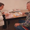 2/13/97--AARP/TAX TIME--DAN CAPPELLAZZO PHOTO--MARILYN KING , AARP TAX AIDE, HELPS NF RESIDENT MARTIN COYNE WITH HIS TAXES AT THE LEWISTON LIBRARY.<br /> <br /> ECHO