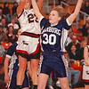 2/25/97-- falcons 2 --tak photo-- Falcon's ace Angela Tylec goes over Erin Ebert for a shot.