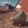 4/10/97 Richard A. Davis - James Neiss Photo - Richard A. Davis, President - C.E.O of Treibacher Schleifmittel Corp. sits on a stretch of rail in need or repair that goes right up to one of his warehouses he would like to use for shipping his companies finished products which the railway said they don't want to maintain. Said he'd like to see a private companie take over short stretches of rail like this.