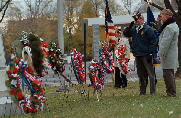 98/11/11 NF VETS/CENOTAPH--DAN CAPPELLAZZO PHOTO--(LTOR) FELIX WASIAK, KOREA, AND PETER BUDREWICZ, WWII, POLISH LEGION OF AMERICAN VETS U.S.A. LT COL MATT URBAN POST #198 SALUTE AFTER PLACING THE LAST WREATH AT CENOTAPH PK IN OBSERVENCE OF VETS DAY.