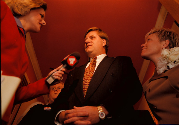 98/11/03 Daly 138th Race - Vino Wong Photo - (middle) Robert and Kelly Daly all smiles for a local television station during the election night at Como Restaurant Tuesday.