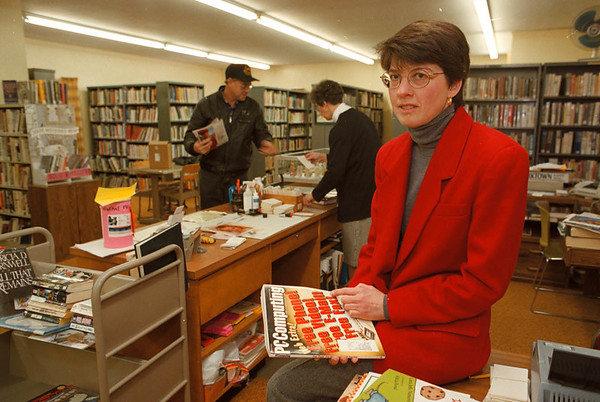 2/10/97--NEWFANE LIBRARY/COUNTY--DAN CAPPELLAZZO PHOTO--JEANNE KERN, LIBRARY DIRECTOR OF THE NEWFANE FREE LIBRARY, SITS WITH A COPY OF PC COMPUTING. SHE HOPES THE COUNTY WILL SUPPLY FUNDING FOR A COMPUTER SYSTEM TO LINK SMALLER LIBRARIES WITH OTHERS COUNTY WIDE.