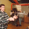 1/24/97 School Reportcard 2 - James Neiss Photo - LewPort High School - Steve Pedley 17/12th grade test launches a indoor model airplain which he wishes to enter into the Science Olympia program.