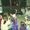 1/9/97--armstrong house/hoops--CAPPY PHOTO--DENA ARMSTRONG HIGH FIVES HER NIECE CASSANDRA STEIN (NU SHIRT AND CAP) AND THE CROWD CHEERS EARLY IN THE GAME AT THE ARMSTRONG HOUSE HOLD IN LEWISTON.<br /> <br /> SP